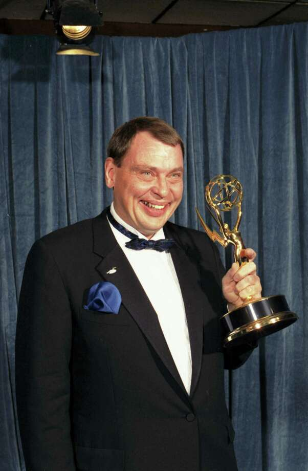 "In this Sunday, Aug. 28, 1988 file photo, Larry Drake holds the Emmy he won for best supporting actor in a drama series for his role as a mentally challenged character in ""L.A. Law,"" at the 40th annual Emmy Awards in Pasadena, Calif. Drake, who earned back-to-back Emmys for his portrayal of Benny Stulwicz, was found dead in his Los Angeles-area home on Thursday, March 17, 2016. He was 66. Photo: AP Photo/Lennox McLendon    / AP"