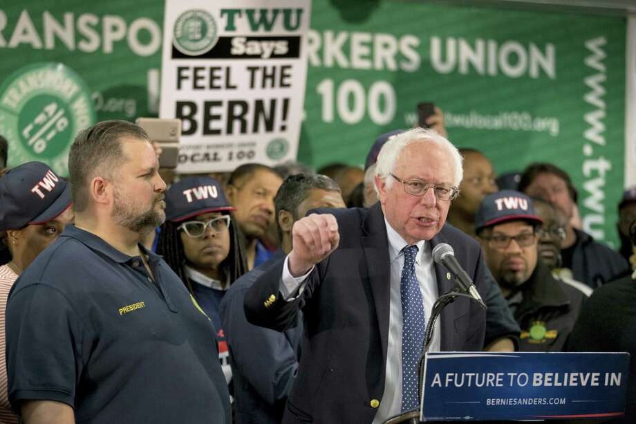 TWU Local 100 President John Samuelsen listens at left as Democratic presidential candidate, Sen. Bernie Sanders, I-Vt. speaks after being endorsed by TWU Local 100, Wednesday, April 13, 2016, in the Brooklyn borough of New York. Photo: AP Photo/Mary Altaffer    / AP