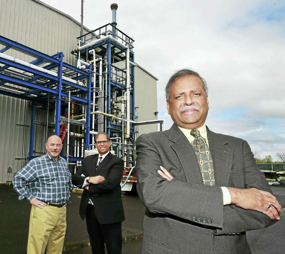 N. C. Murthy, President and CEO of New Haven Chlor-Alkali, doing business as H. Krevit & Company, right, with Bruce H. Wilson Jr. senior vice-president of operations, left, and Thomas Ross, senior vice-president of sales, center, stand by a hydrochloric acid synthesis unit at the 97-year-old New Haven based company, Friday, May 6, 2016. New Haven Chlor-Alkali, as H. Krevit & Company, manufactures sodium hypochlorite (bleach), caustic soda and hydrochloric acid from salt to be used a water treatment chemicals. Photo: Peter Hvizdak — New Haven Register   / ©2016 Peter Hvizdak