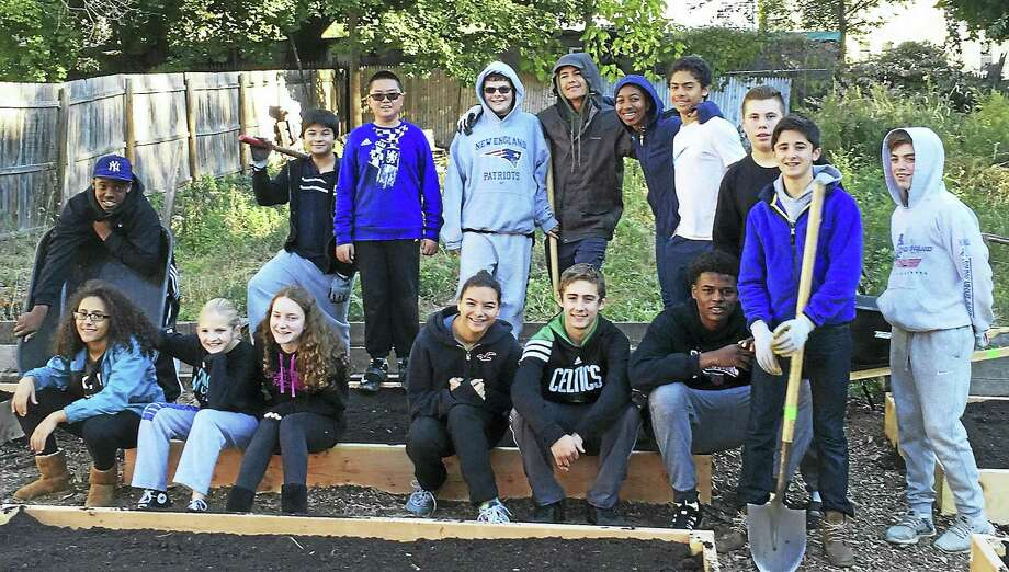 Hamden Hall Country Day School students and faculty members prepped garden beds for the spring in the Hill section of New Haven. The school is working with the nonprofit New Haven Land Trust to maintain and prepare several community gardens. The community service initiative is designed to introduce middle school students to the benefits of community gardening, sustainability and healthful eating. Photo: Contributed File Photo
