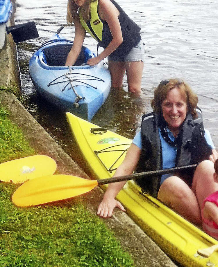 Kayaking in Connecticut means washing your vessel before launching it Photo: Journal Register Co.