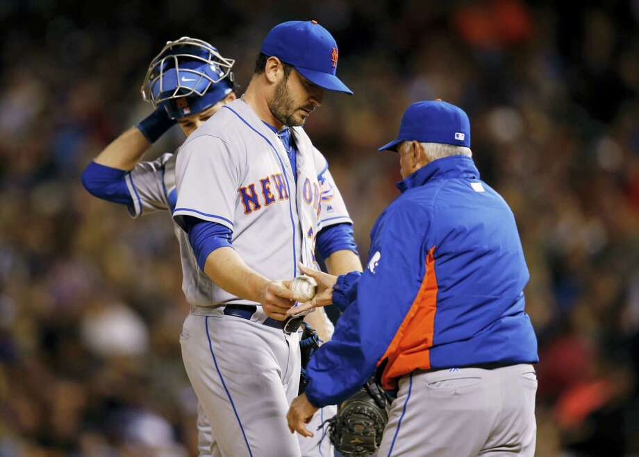 Mets starting pitcher Matt Harvey, center, hands the ball to manager Terry Collins as he is pulled from the game in the sixth inning. Photo: David Zalubowski — The Associated Press   / Copyright 2016 The Associated Press. All rights reserved. This material may not be published, broadcast, rewritten or redistribu