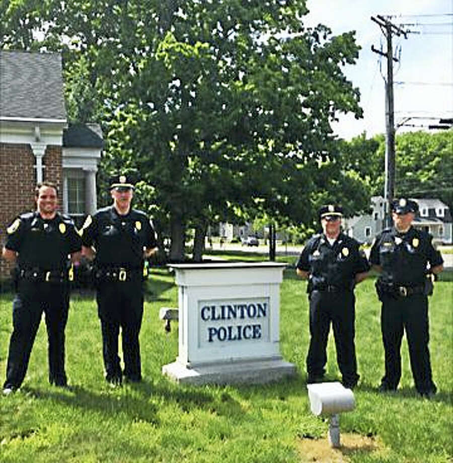 From left are Clinton police officer David Cairns, Sgt. Jeremiah Dunn, Chief Vincent DeMaio and officer Joseph O'Brien in their new blues. Photo: Contributed Photo