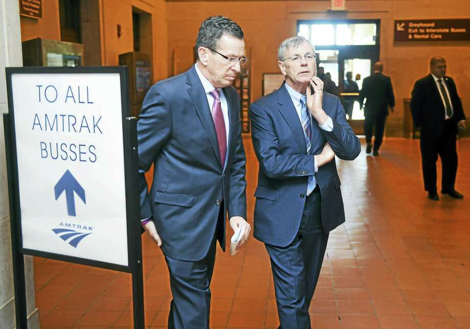 Gov. Dannel P. Malloy, left, confers with Connecticut Department of Transportation Commissioner James Redeker at Union Station in New Haven. The governor and the General Assembly are pushing the adoption of a state constitutional amendment to establish a lockbox for transportation tax revenue. Photo: File Photo