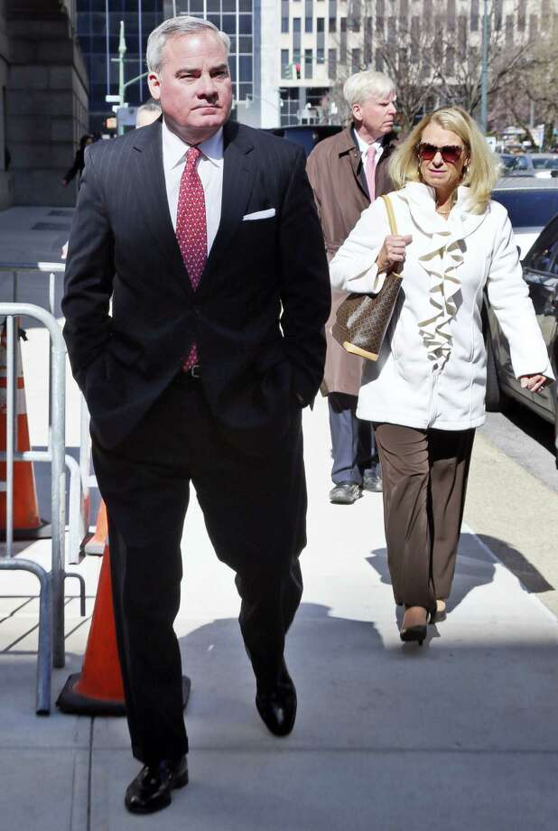 Former Connecticut Gov. John Rowland, left, leaves with his wife Patricia, right, at federal appeals court on Friday, March 18, 2016 in New York. Rowland has asked a federal appeals court to overturn his political corruption conviction. Photo: AP Photo — Bebeto Matthews / Copyright 2016 The Associated Press. All rights reserved. This material may not be published, broadcast, rewritten or redistributed without permission.