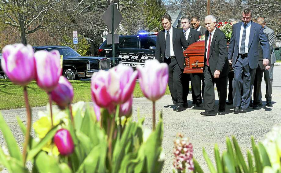 Pallbearers bring the casket of Daniel P. Cosgrove into St. Mary's Church in Branford Friday. Photo: Peter Hvizdak — New Haven Register   / ?2016 Peter Hvizdak