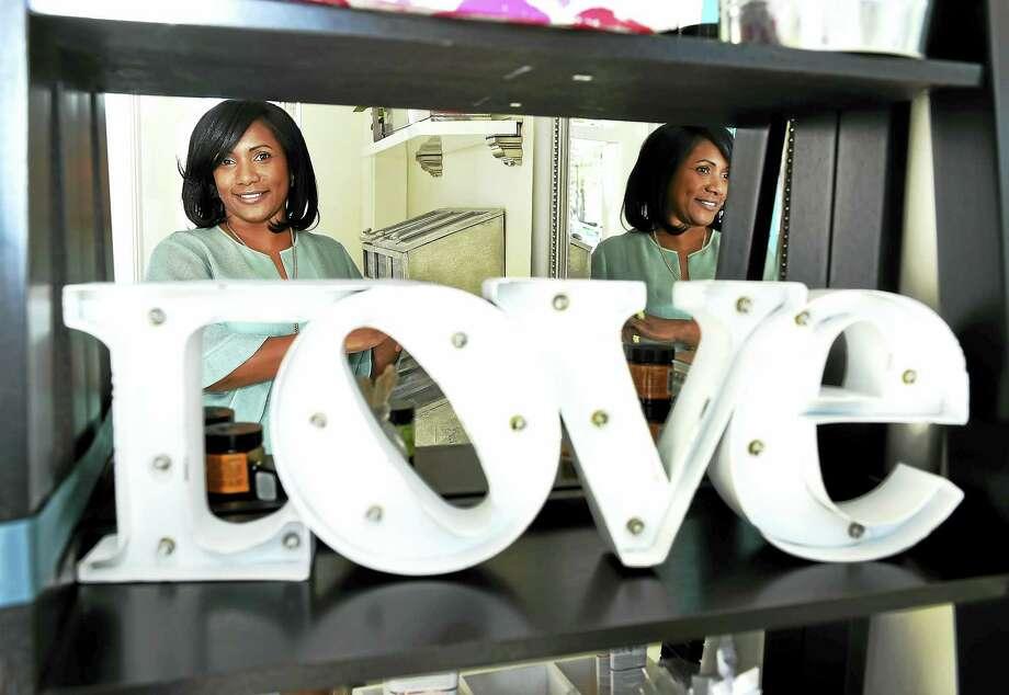 Cristina Lopes Ayers, owner of VoVo Organics, in her Hamden shop. Photo: Peter Hvizdak — New Haven Register   / ?2016 Peter Hvizdak