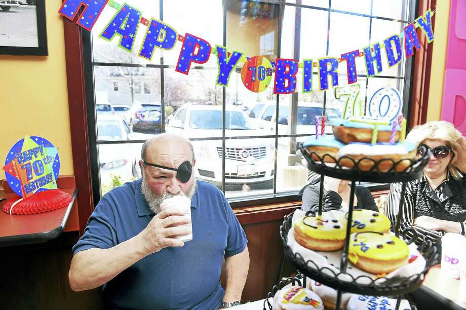 Michael Marcus celebrated his 70th birthday with family and friends at the Dunkin' Donuts at 275 Boston Post Road in Milford Friday, where he tasted coffee for the first time in his life. Photo: Arnold Gold — New Haven Register