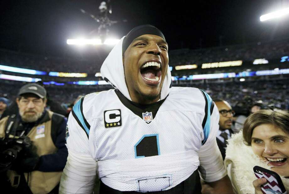 Carolina Panthers' Cam Newton celebrates after leading the Panthers to a 49-15 win over the Arizona Cardinal. Photo: Chuck Burton – The Associated Press   / AP