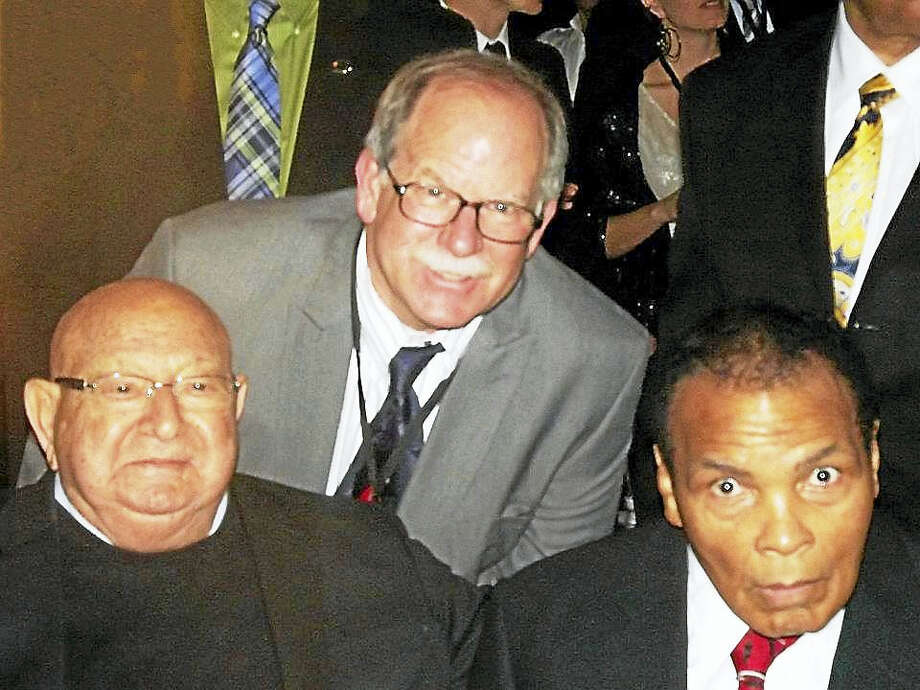 Rick Kaletsky stands between Muhammad Ali's trainer, Angelo Dundee, and Ali at Ali's 70th birthday party in Louisville, Ky., in 2012. Photo: CONTRIBUTED PHOTO