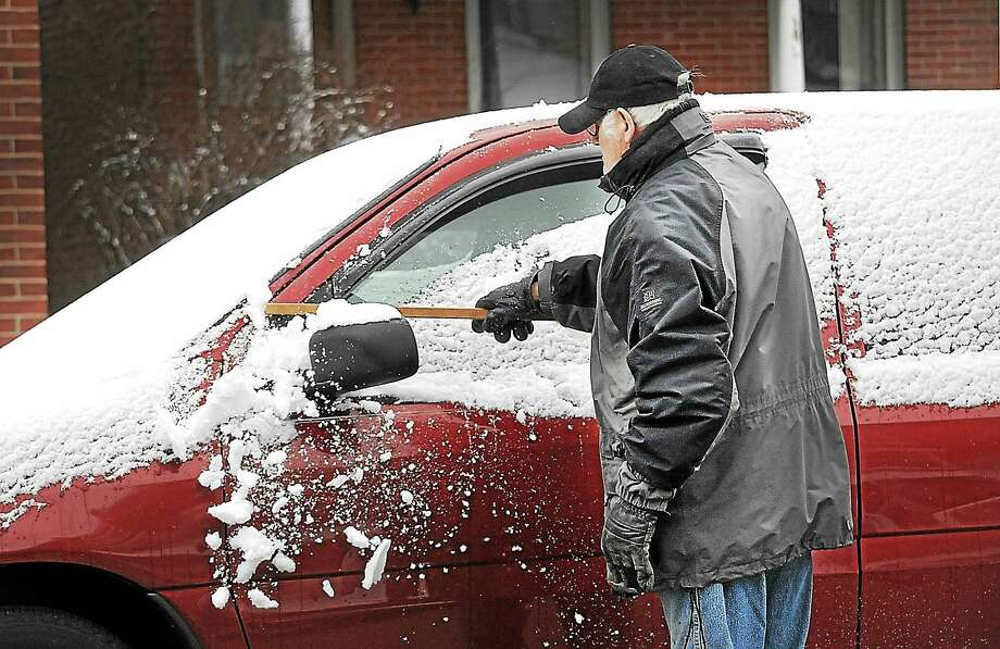In this file photo, a motorist cleans snow off his car along Stanbridge Street in Norristown March 4, 2016 Photo: Gene Walsh — Digital First Media   / Digital First Media