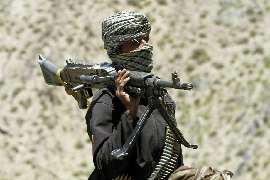 In this May 27 photo, a member of a breakaway faction of the Taliban fighters guards a gathering in Shindand district of Herat province, Afghanistan. Photo: THE ASSOCIATED PRESS   / Copyright 2016 The Associated Press. All rights reserved. This material may not be published, broadcast, rewritten or redistribu