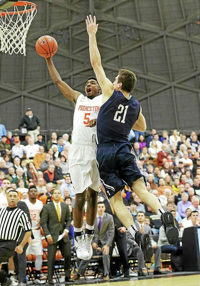 Princeton's Amir Bell (5) is fouled by Yale's Nick Victor on a shot attempt during Friday's game at Jadwin Gym. Photo: John Blaine — The Trentonian