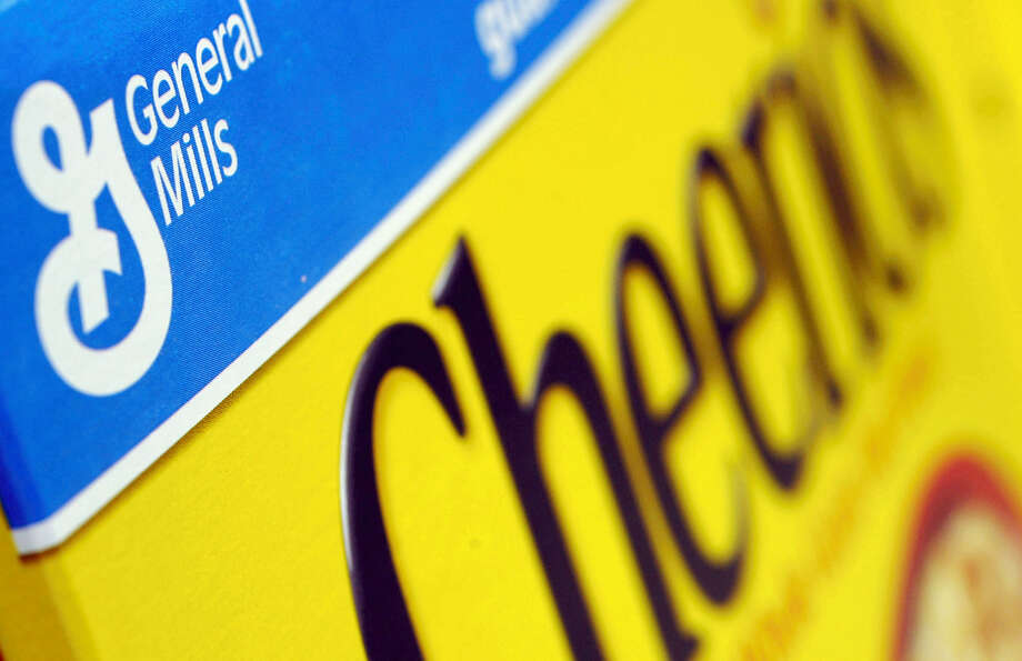 FILE - In this Dec. 15, 2007 file photo, a box of General Mills' Cheerios is seen on a shelf at a Shaw's Supermarket in Gloucester, Mass.  General Mills says it will start labeling products across the country that contain genetically modified ingredients to comply with a law that is set to go into effect in Vermont. The maker of Cheerios cereal, Progresso soups and Yoplait yogurt notes it is impractical to label its products for just one state, so the disclosures required by Vermont starting in July 2016 will be on its products throughout the U.S. Photo: THE ASSOCIATED PRESS / ap