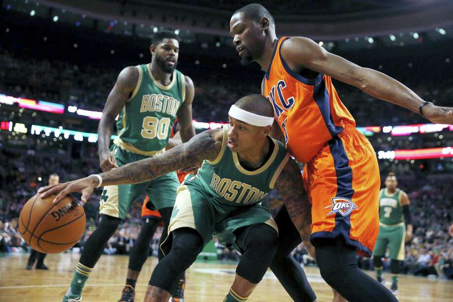 Oklahoma City Thunder's Kevin Durant, right, defends against Boston Celtics' Isaiah Thomas, center, during the first quarter Wednesday in Boston. Photo: The Associated Press   / Copyright 2016 The Associated Press. All rights reserved. This material may not be published, broadcast, rewritten or redistributed without permission.