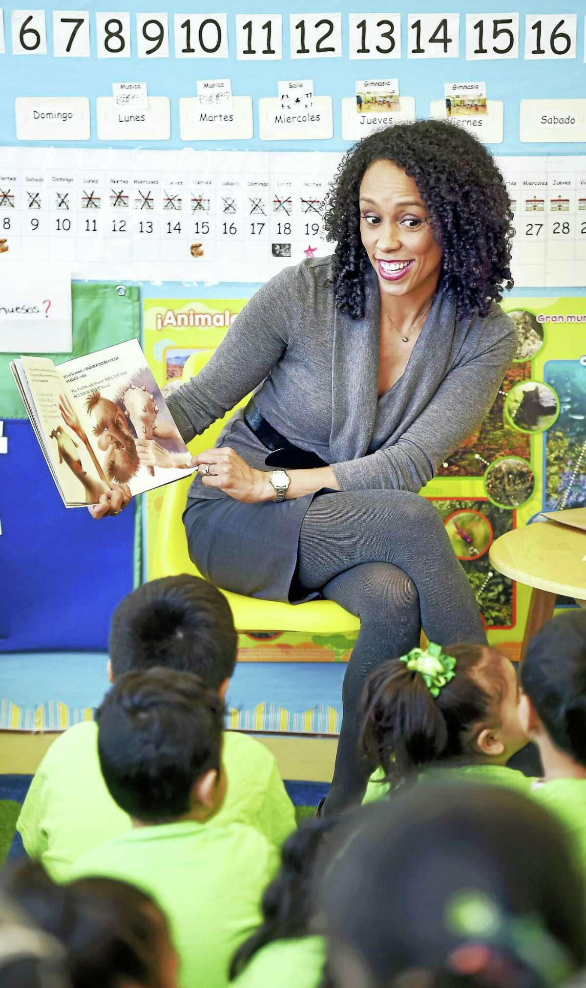 """Myra Jones-Taylor, commissioner of the Office of Early Childhood, reads """"Three Billy Goats Gruff"""" in English to a group of Head Start pre-K students at John S. Martinez School in New Haven on Friday. The bilingual students also heard the book in Spanish."""