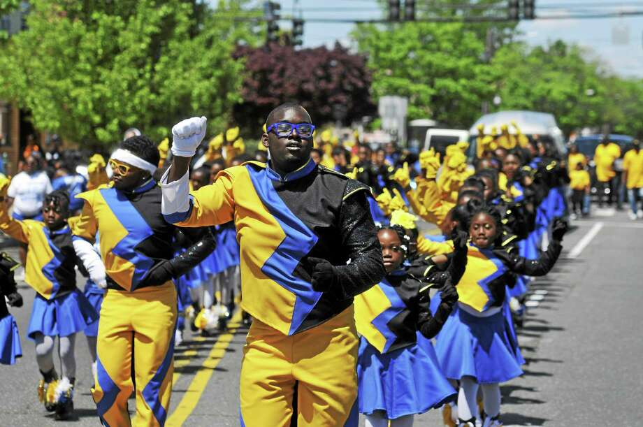 A scene from the 2014 Freddie Fixer parade along Dixwell Avenue, from Hamden to New Haven. Photo: Peter Casolino — New Haven Register FILE PHOTO