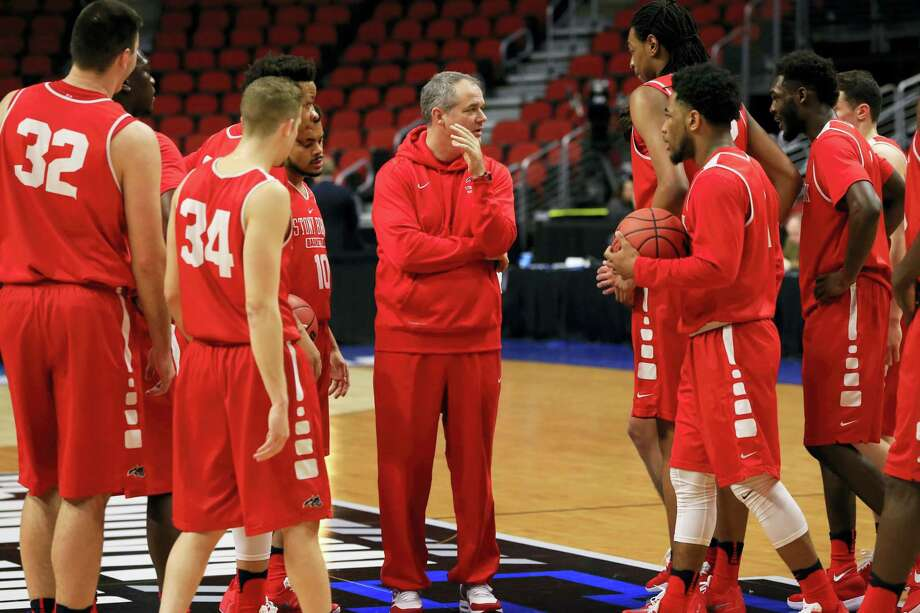Stony Brook coach Steve Pikiell, center, gathers his players during practice ahead of a first-round men's college basketball game in the NCAA Tournament in Des Moines, Iowa, Wednesday, March 16, 2016. Stony Brook will play Kentucky on Thursday. (AP Photo/Nati Harnik) Photo: AP / Copyright 2016 The Associated Press. All rights reserved. This material may not be published, broadcast, rewritten or redistributed without permission.