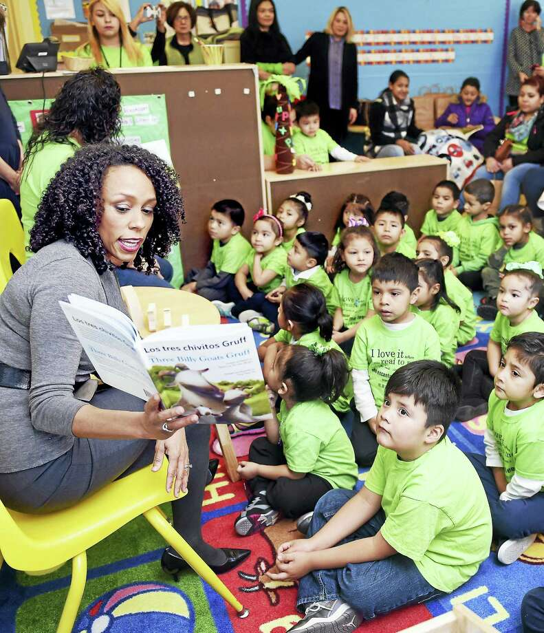 Myra Jones-Taylor, Commissioner of the Office of Early Childhood, reads Three Billy Goats Gruff in English to a group of Head Start pre-K students at John S. Martinez School in New Haven late last week. The bilingual students also heard the book in Spanish. Photo: Arnold Gold — New Haven Register