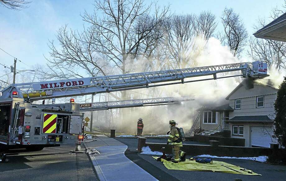 A fire broke out Thursday afternoon at 334 Milford Point Road in Milford. Crews were able to contain the flames quickly but the home sustained extensive damage. Photo: Courtesy Of Milford Fire Department