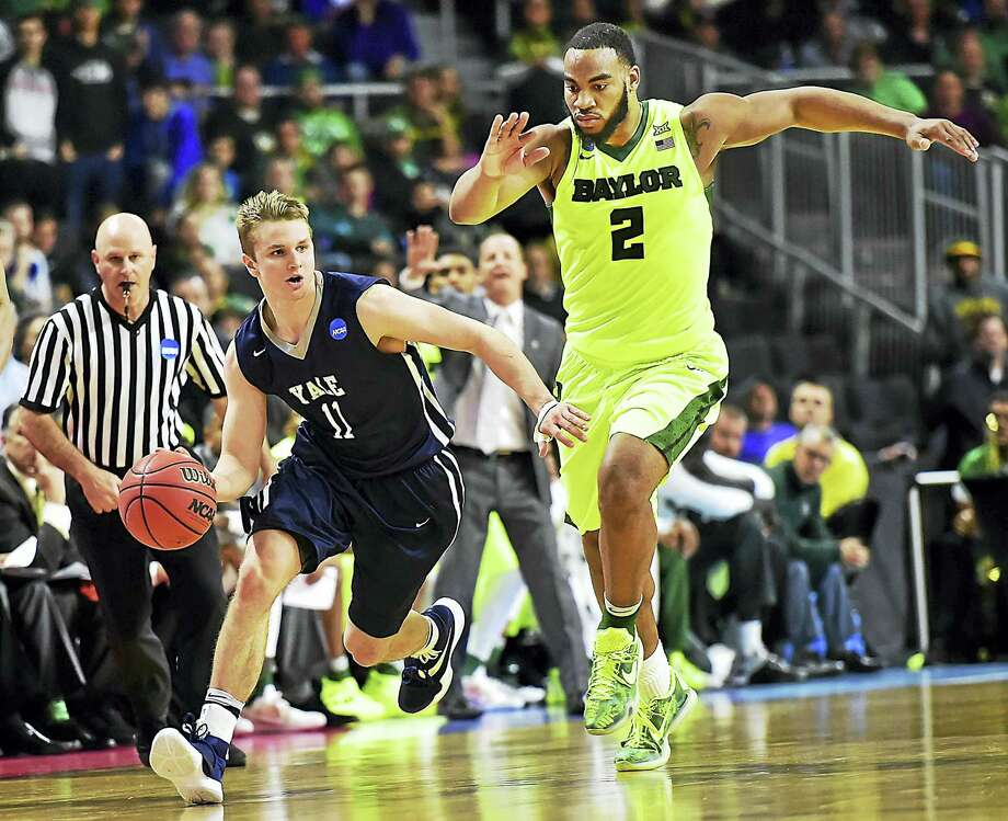 Yale's Makai Mason takes off on a fastbreak as Baylor's Rico Gathers defends in the final seconds of a 79-75 victory for the Bulldogs in the first round of the NCAA tournament at the Dunkin' Donuts Center in Providence, RI. Photo: Catherine Avalone — Register   / New Haven RegisterThe Middletown Press
