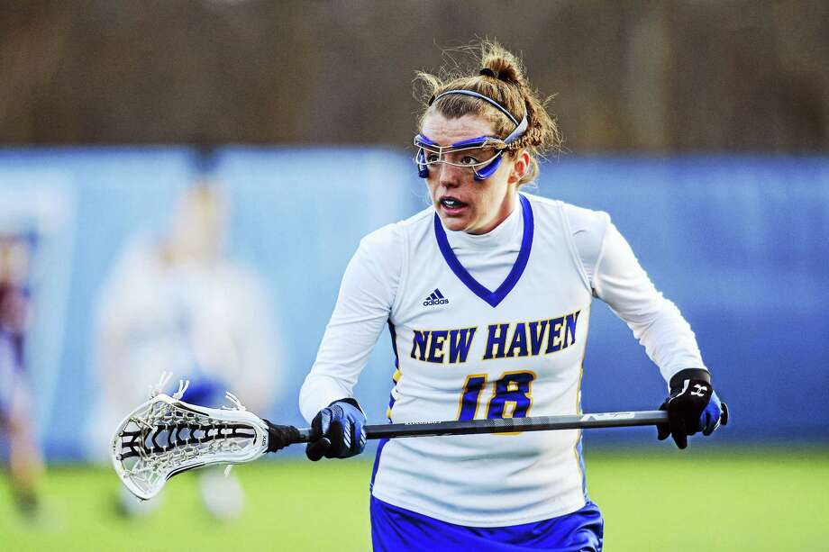 Hannah Johnson of Madison, who starred at Hand, has teamed with former SCC foes Caitlin O'Brien and Alicia Mortali to lead the New Haven women's lacrosse team to its third straight NCAA tournament appearance. Photo: Courtesy New Haven Athletics   / © 2015 Clarus Studios Inc.