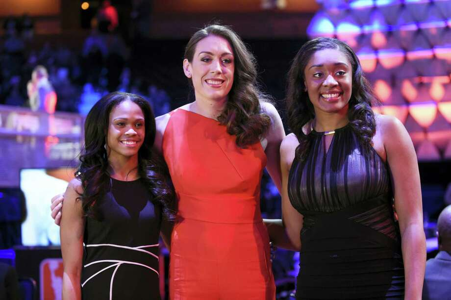 From left, UConn's Moriah Jefferson, Breanna Stewart and Morgan Tuck pose for photographs before Thursday's WNBA draft. Photo: Cloe Poisson — Hartford Courant Via AP   / Hartford Courant