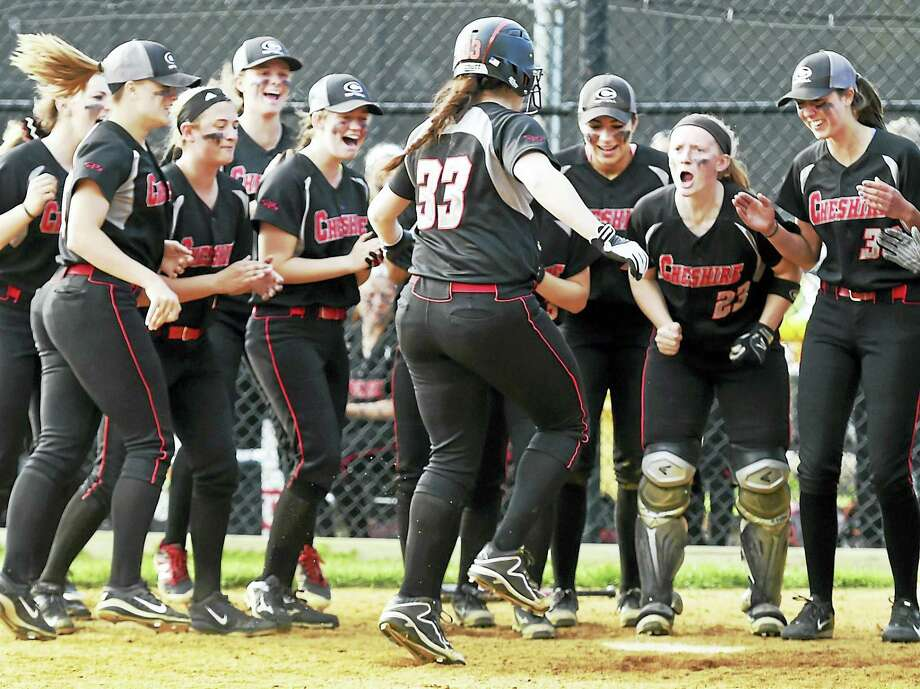 Cheshire High's softball team welcomes Abigail Abramson after she hit an 8th inning home run making the score 4-3 over Amity High School Wednesday. Cheshire defeated Amity 5-4 in nine innings. Photo: Photo By Peter Hvizdak — The New Haven Register   / ?2016 Peter Hvizdak