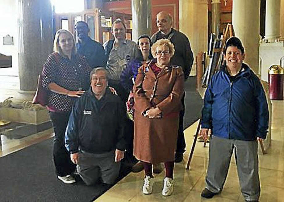 HARC advocates pose for a picture on the first floor of the state Capitol. Photo: Christine Stuart — CT News Junkie