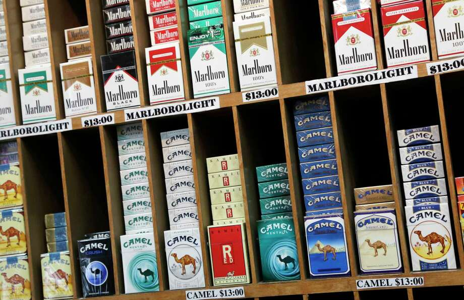 Cigarette packs are displayed at a convenience store in New York. Photo: AP Photo/Mark Lennihan   / AP2013