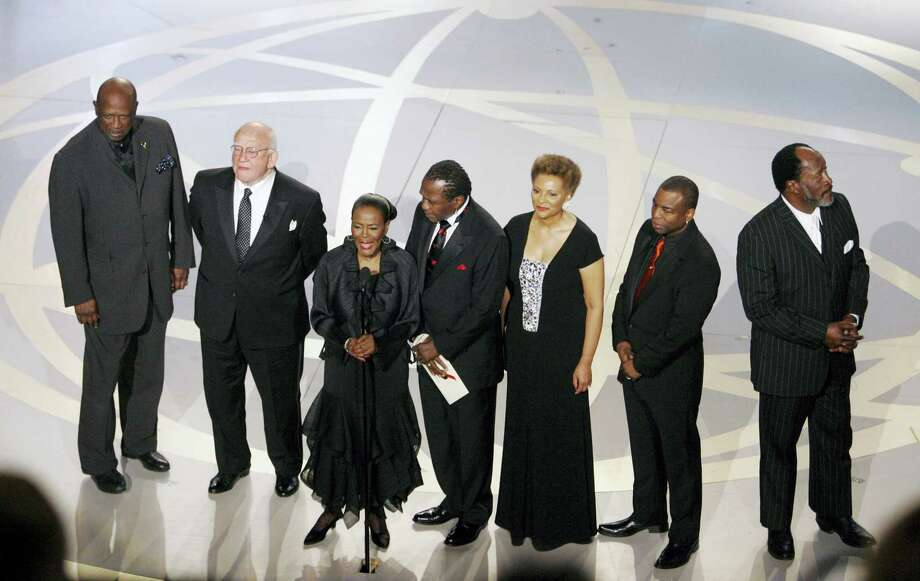 "In this Sept. 16, 2007, file photo, ""Roots"" cast members from left, Louis Gossett Jr., Edward Asner, Cicely Tyson, Ben Vereen, Leslie Uggams, LaVar Burton and John Amos participate in a tribute to ""Roots"" during the 59th Primetime Emmy Awards in Los Angeles.  In time for its 40th anniversary next year, ""Roots: The Complete Original Series"" is being re-released June 7, 2016, on Blu-ray by Warner Bros. Photo: AP Photo/Mark J. Terrill, File    / AP"