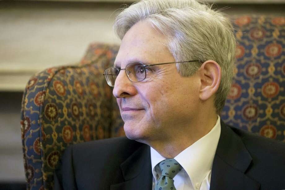 Judge Merrick Garland, President Barack Obama's choice to replace the late Justice Antonin Scalia on the Supreme Court, sits during a meeting with Sen. Patrick Leahy, D-Vt., on Capitol Hill in Washington Thursday. Photo: J. Scott Applewhite — The Associated Press   / AP