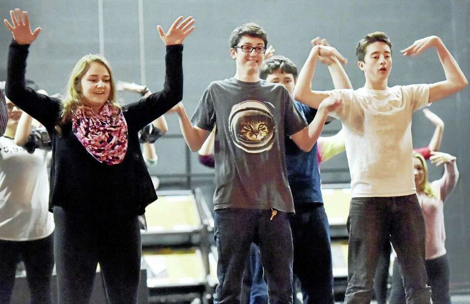 "From left, North Branford High School students Vittoria Cristante as Rizzo, Dylan Wilson as Kenickie and Spencer Wilson as Danny rehearse ""Grease."" Photo: Peter Hvizdak — New Haven Register   / ©2016 Peter Hvizdak"