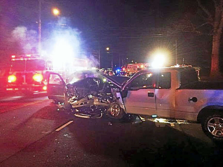 Two men were taken to Yale-New Haven Hospital late Wednesday night after a head-on crash on Washington Avenue in North Haven. Firefighters worked for 38 minutes to extricate one of the men from the wreck. Photo: Courtesy Of North Haven Fire Department