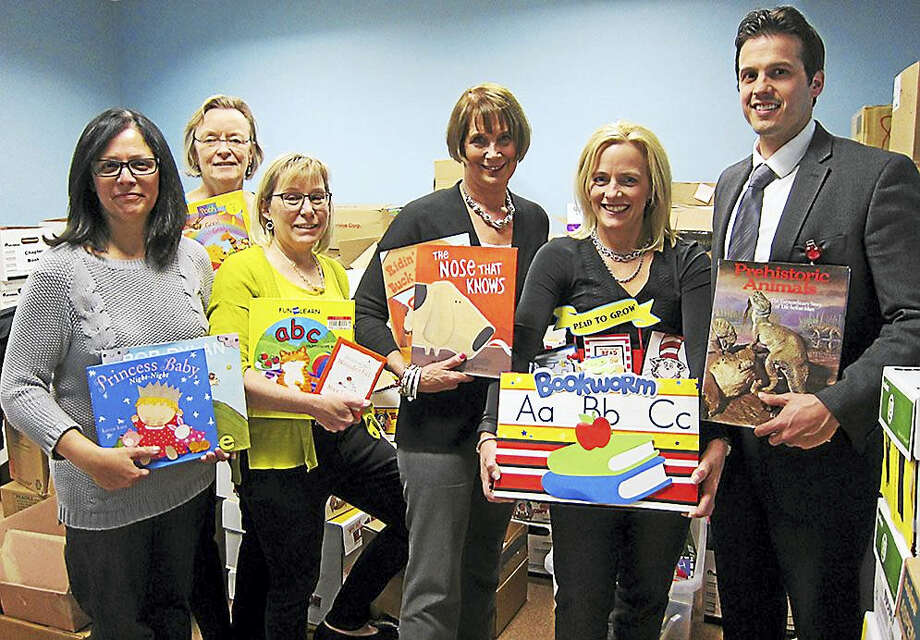 From left, Read to Grow Associate Evelyn Tomasello; Executive Director Kyn Tolson; and Coordinator Linda Sylvester; NEMG practice Supervisor Jean Noyes; practice Coordinator Cindy Diotalevi; and practice Operation Manager Rick Coppola. Photo: CONTRIBUTED PHOTO — Northeast Medical Group