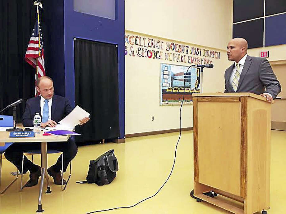 New Haven Public Schools CFO Victor De La Paz, right, presents his initial budget proposal to the Board of Education on Feb. 16. Superintendent of Schools Garth Harries listens at left. Photo: Brian Zahn — New Haven Register