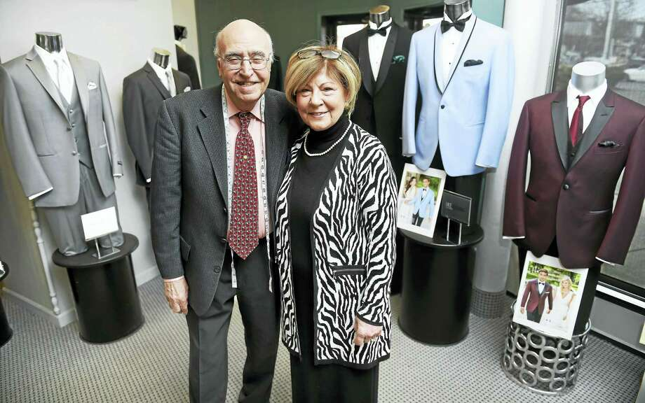 (Arnold Gold-New Haven Register)  Camillo Tramontana and his wife, Angela, at their Norwalk store, Camillo's Tuxedo Specialist, last week. Photo: Journal Register Co.