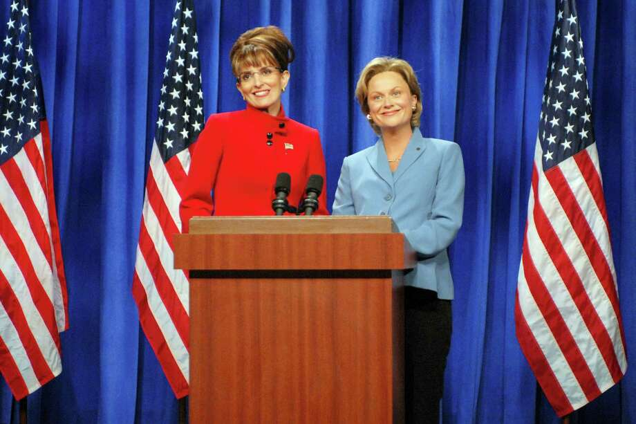 "In this Sept. 13, 2008 photo released by NBC, Tina Fey portrays Alaska Gov. Sarah Palin, left, and Amy Poehler as Sen. Hillary Clinton during a skit on ""Saturday Night Live,"" in New York. Photo: AP Photo/NBC, Dana Edelson   / NBC"