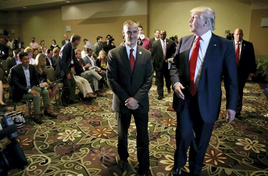 In this Aug. 25, 2015, file photo, Republican presidential candidate Donald Trump, right, walks with his campaign manager Corey Lewandowski after speaking at a news conference in Dubuque, Iowa. A Florida prosecutor's office plans to hold a news conference Thursday, April 14, 2016, amid reports that presidential candidate Donald Trump's campaign manager Lewandowski won't be prosecuted over a videotaped altercation with a female reporter. Photo: AP Photo — Charlie Neibergall, File / AP