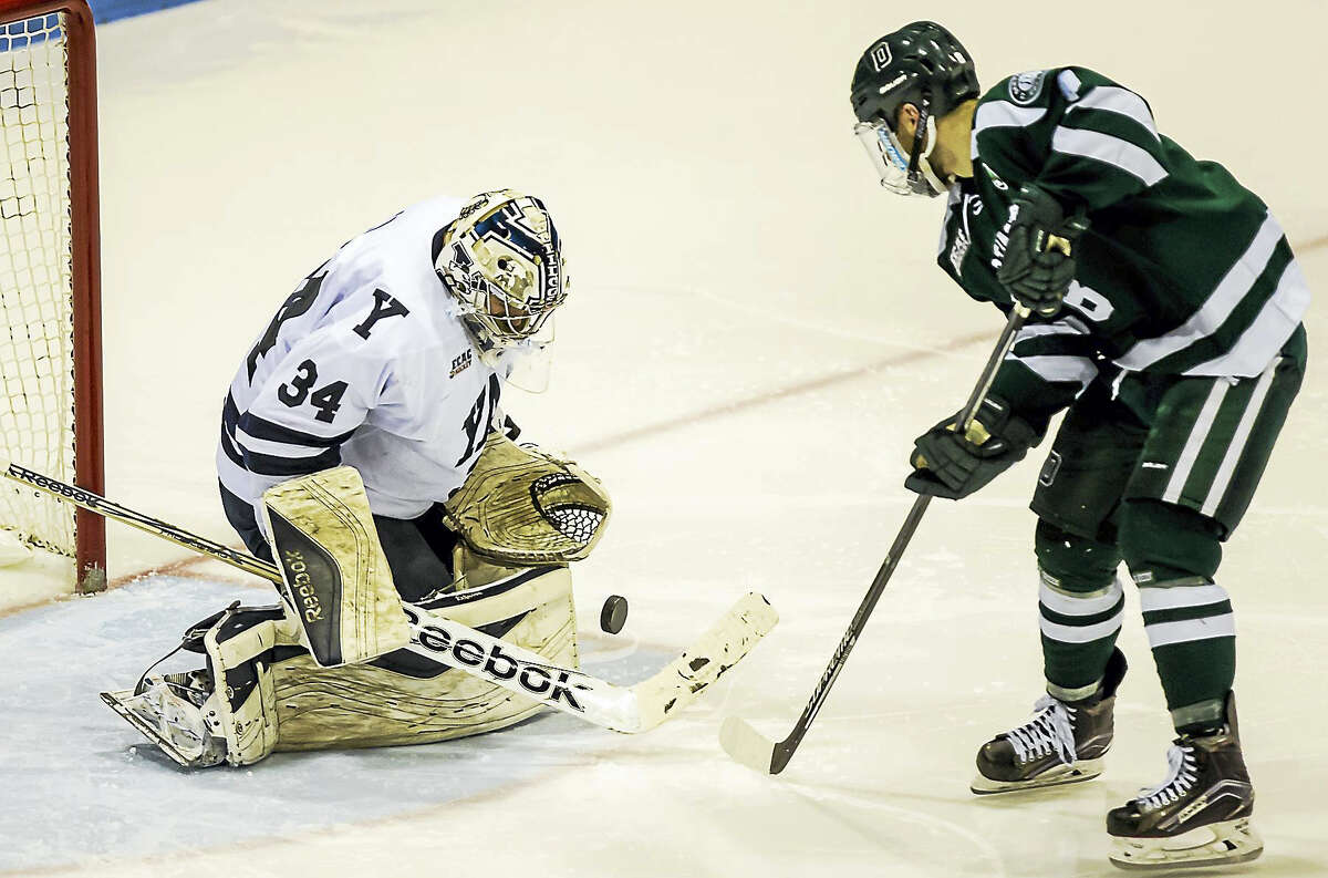 Yale goaltender Alex Lyon makes a breakaway save off the shot of Dartmouth's Tim O'Brien during Yale's Quaterfinal opening game at Ingall's Friday evening.-John Vanacore/Register