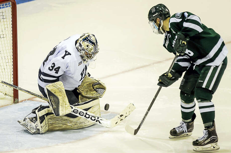 Yale goaltender Alex Lyon makes a breakaway save off the shot of Dartmouth's Tim O'Brien during  Yale's Quaterfinal opening game at Ingall's Friday evening.-John Vanacore/Register Photo: Journal Register Co. / (c)John H.Vanacore-New Haven Register