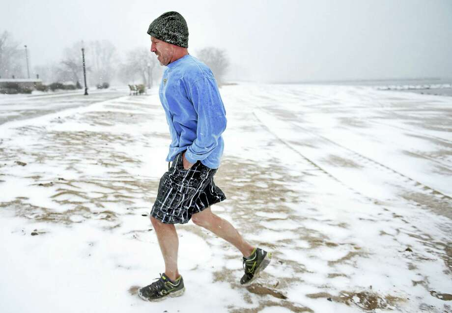 Todd Strickland of Madison walks back from the beach at Savin Rock in West Haven Saturday morning, 1/23/2016, after the 16th Annual Icy Plunge for the Cure was postponed until February. Photo: Arnold Gold-New Haven Register