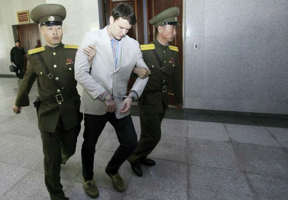 American student Otto Warmbier is escorted at the Supreme Court Wednesday in Pyongyang, North Korea. Photo: Associated Press   / AP