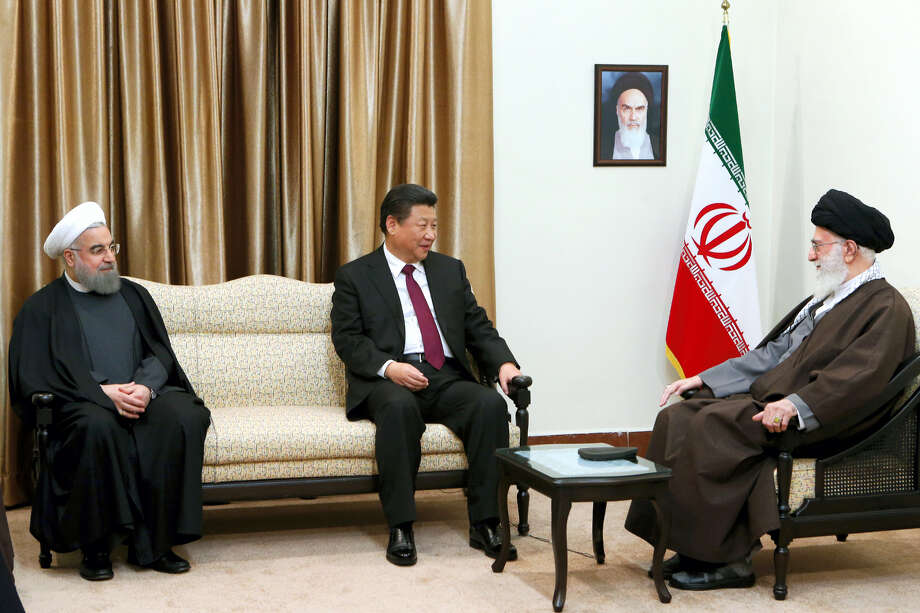 "In this Saturday, Jan. 23, 2016, photo released by an official website of the office of the Iranian supreme leader, Supreme Leader Ayatollah Ali Khamenei, right, meets with Chinese President Xi Jinping, center, and Iranian President Hassan Rouhani, in Tehran, Iran. Xi Jinping, visiting Iran just days after the lifting of international sanctions under a historic nuclear deal, said he hopes for a ""new chapter"" in relations. Photo: Office Of The Iranian Supreme Leader Via AP    / Office of the Iranian Supreme Leader"