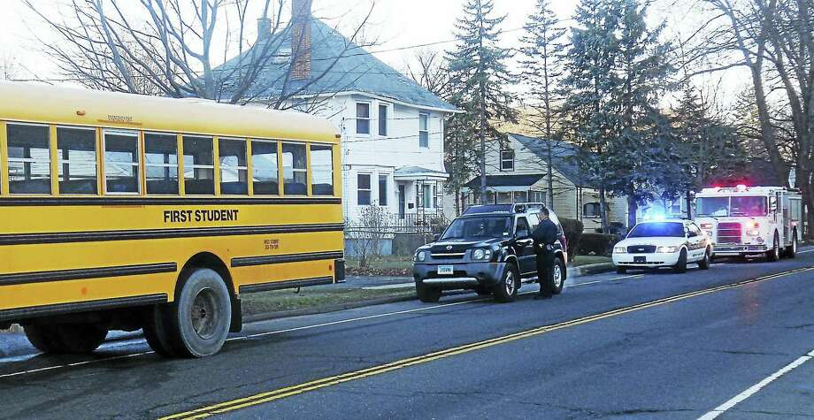 Part of Quinnipiac Avenue was congested for a short time Wednesday morning after an SUV reportedly rear-ended a school bus. No one was hurt in the accident. Photo: Wes Duplantier — The New Haven Register