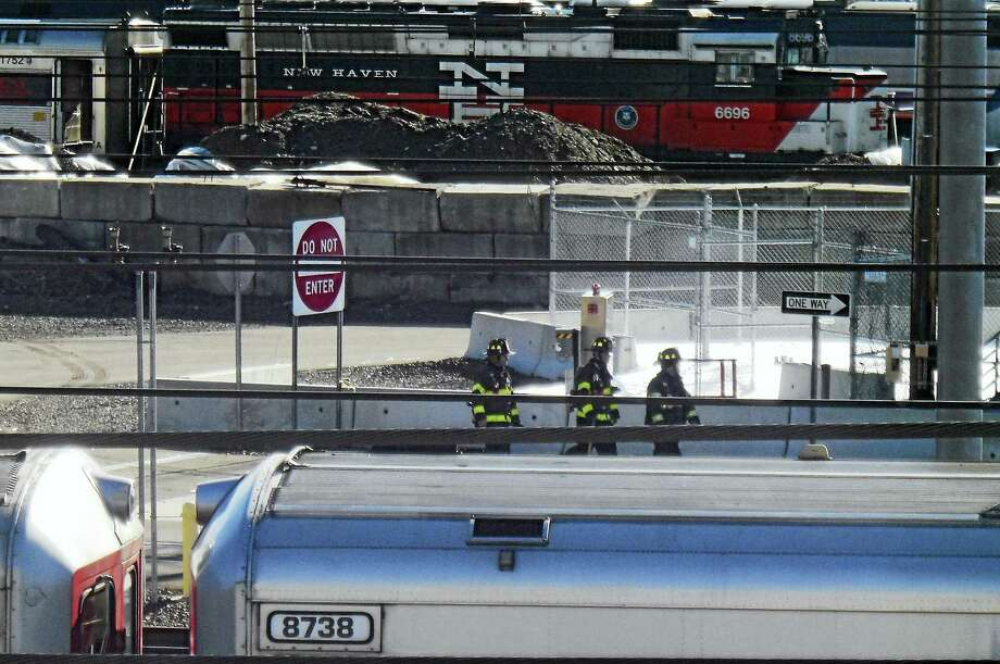 New Haven firefighters responded Wednesday morning after a power surge at an Amtrak facility on Hallock Avenue caused a foam discharge. Photo: Wes Duplantier — New Haven Register