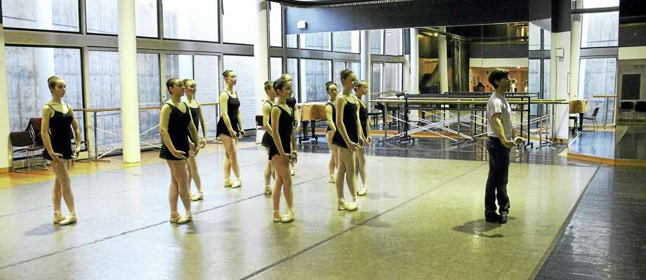 Tom Gold, right, and advanced students work on a piece at New Haven Ballet studios on Audubon Street. Photo: Photo Courtesy Of Mike Franzman