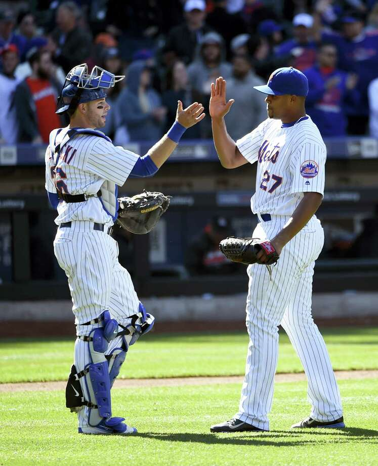 Mets catcher Kevin Plawecki, left, congratulates relief pitcher Jeurys Familia after the Mets beat the Marlins Wednesday in New York. Photo: Kathy Kmonicek — The Associated Press   / FR170189 AP