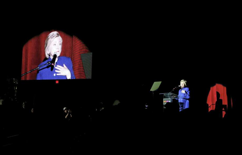 Democratic presidential candidate Hillary Clinton, right, speaks at a concert at the Greek Theatre, Monday, June 6, 2016, in Los Angeles. Photo: AP Photo/John Locher    / Copyright 2016 The Associated Press. All rights reserved. This material may not be published, broadcast, rewritten or redistribu