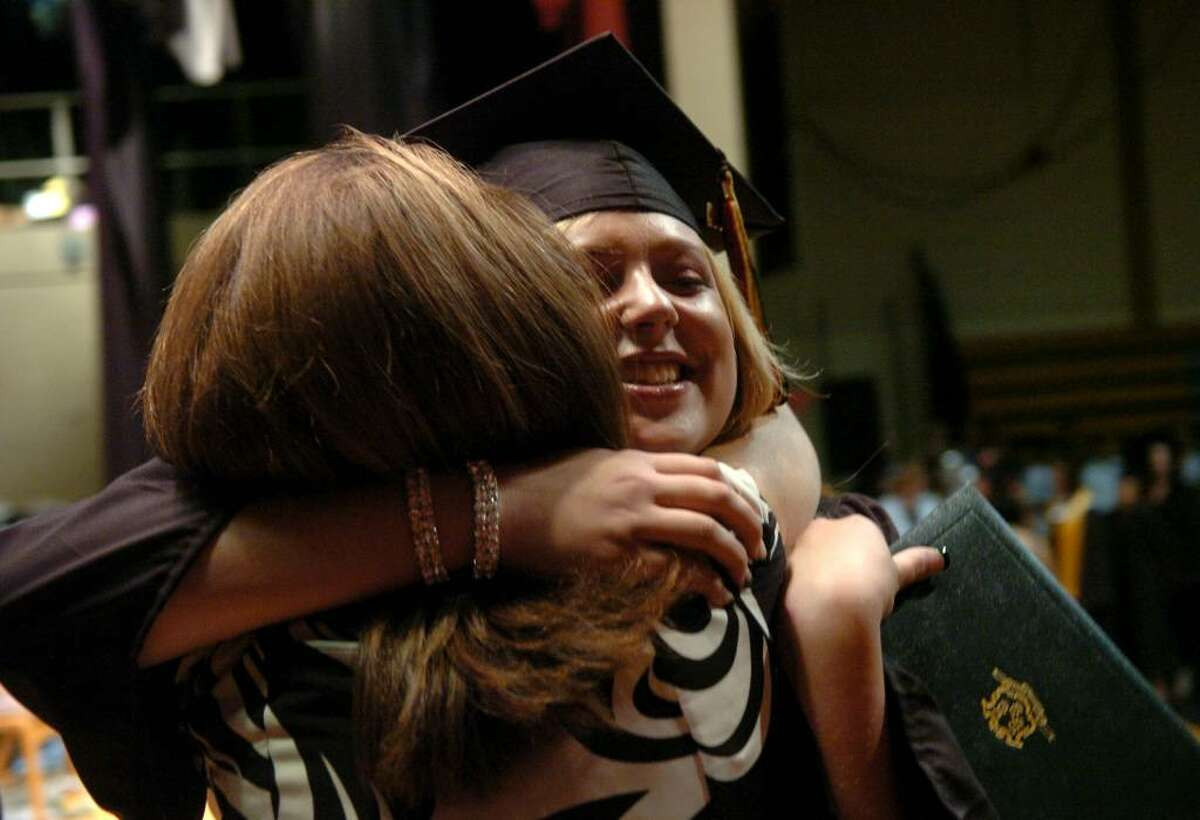 Student Lisa Marie Juliano hugs her teacher Darlene Richichi after getting her diploma at Platt Technical School's graduation ceremony in Milford, Conn. on Friday June 11, 2010.